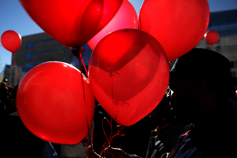 . Balloons were released into the sky in support during a rally seeking justice for Marvin Lewis Booker, who was killed during an altercation with deputies while being booked on charges of possession of drug paraphernalia in 2010. Denver Detention Center on Wednesday, March 12, 2014. (Photo By AAron Ontiveroz/ The Denver Post)