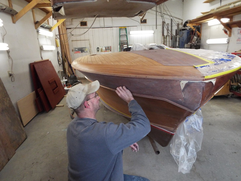 Sanding the top starboard plank after three coats of epoxy were applied.