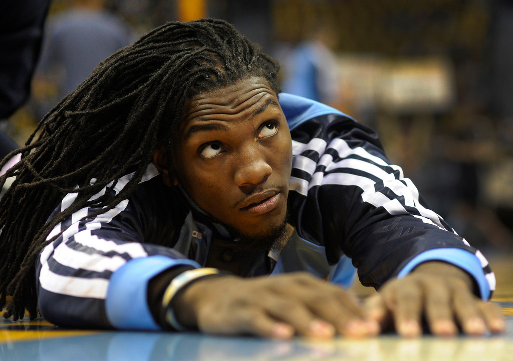 . DENVER, CO. - NOVEMBER 1:  Denver forward Kenneth Faried stretched out before the game. The Denver Nuggets hosted the Portland Trail Blazers Friday night, November 1, 2013 at the Pepsi Center.  Photo By Karl Gehring/The Denver Post