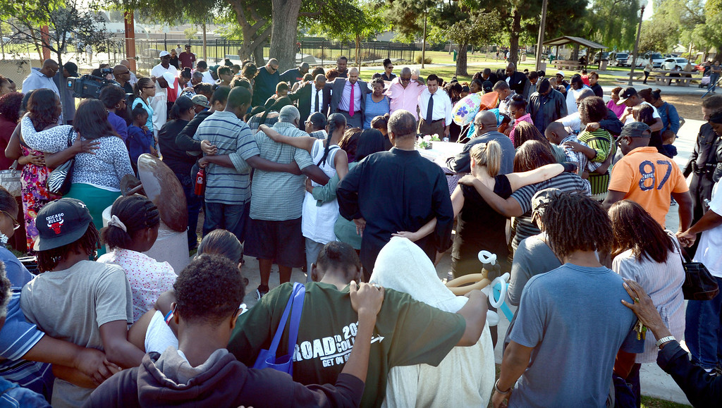 . Long Beach, Calif., -- 10-12-13- Friends and family gather at the scene where teacher Kellye Taylor,53, was fatally  stabbed in front of her students, at Orizaba Park  Friday October 11th 2013, in Long Beach Calif.    Stephen Carr/  Daily Breeze