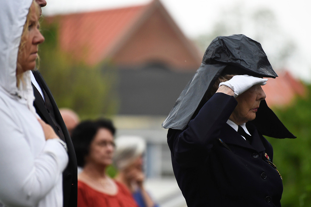 . Kayla Rice/Reformer State Director of the Green Mountain WAVES (Women Accepted for Voluntary Emergency Service) Jane McCauley salutes during the Memorial Day service at the Brattleboro Common on Monday morning.