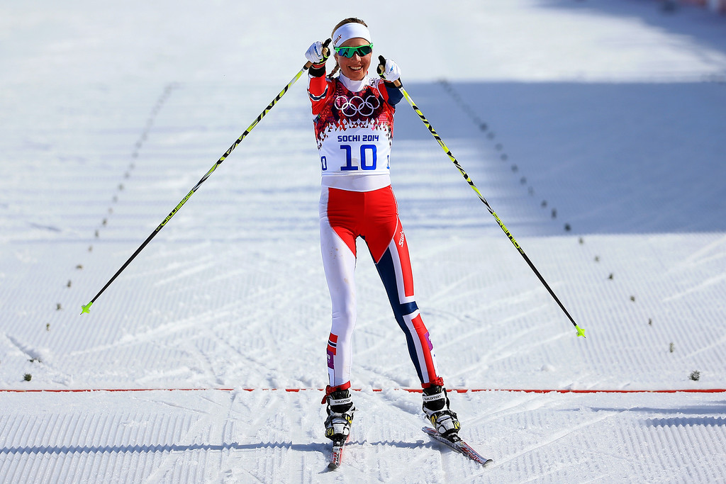 . SOCHI, RUSSIA - FEBRUARY 22:  Kristin Stoermer Steira of Norway celebrates crossing the finish line in third place to win the bronze medal in the Women\'s 30 km Mass Start Free during day 15 of the Sochi 2014 Winter Olympics at Laura Cross-country Ski & Biathlon Center on February 22, 2014 in Sochi, Russia.  (Photo by Richard Heathcote/Getty Images)