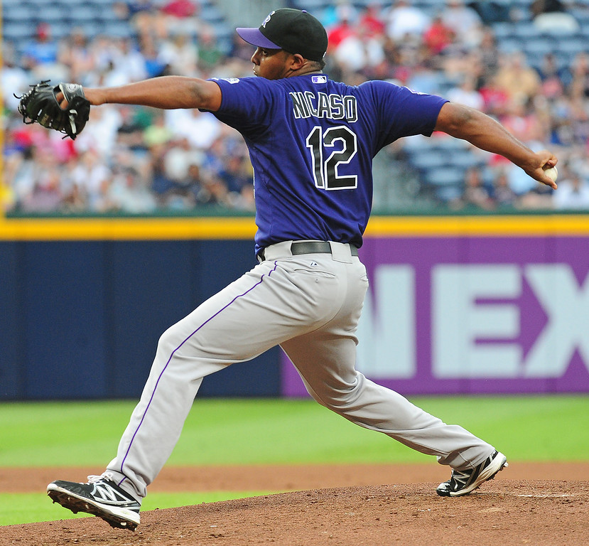 . Juan Nicasio #12 of the Colorado Rockies pitches against the Atlanta Braves at Turner Field on July 30, 2013 in Atlanta, Georgia. (Photo by Scott Cunningham/Getty Images)