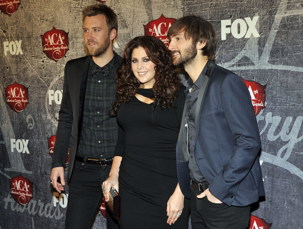 . From left, musicians Charles Kelley, Hillary Scott and Dave Haywood of Lady Antebellum arrive at the American Country Awards on Monday, Dec. 10, 2012, in Las Vegas. (Photo by Jeff Bottari/Invision/AP)