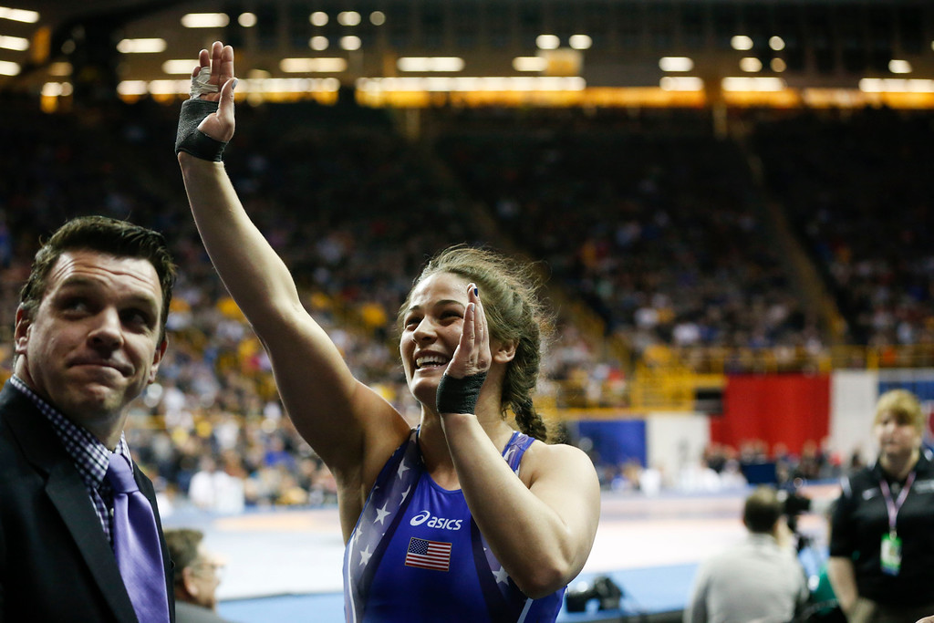 . Denver\'s Adeline Gray waves to her family after beating Victoria Francis in their second bout in the championship round at the 2016 U.S. Olympic Trials at Carver-Hawkeye Arena in Iowa City, Iowa on Sunday, April 10, 2016. The three-time world champion hopes to become the first American woman to win an Olympic gold medal in Rio this summer. Gray won the bout by decision 10-0, earning a spot on the United States Olympic Team. (Rebecca F. Miller for The Denver Post)