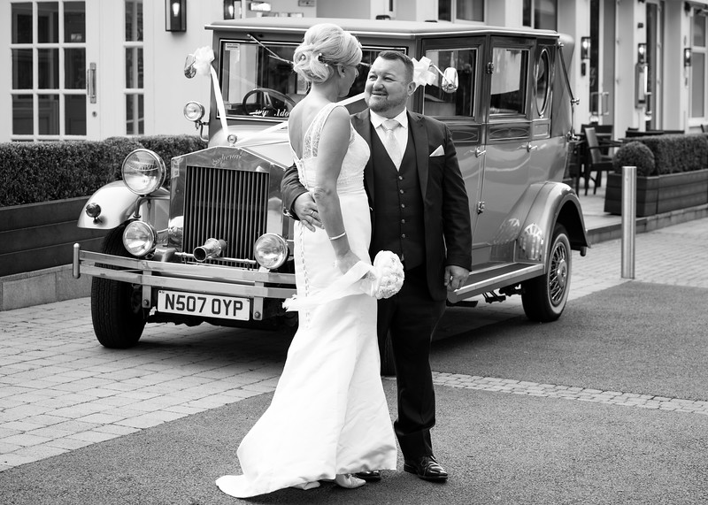 Bride and Groom wtih Car Millbrook Lodge.jpg