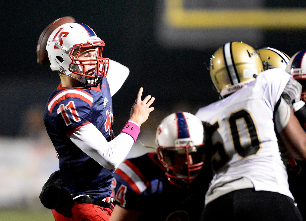 . La Salle\'s quarterback Will Plyburn throws a pass as they play Bishop Montgomery during Friday night\'s football game at La Salle High School in Pasadena, October 25, 2013.  (Photo by Sarah Reingewirtz/Pasadena Star-News)