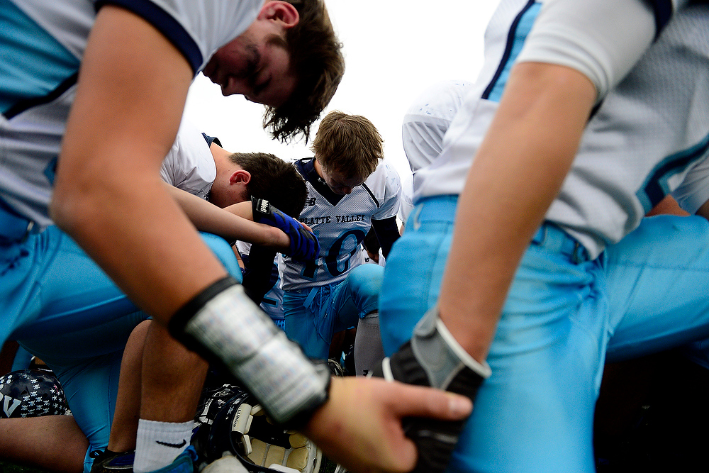 . Platte Valley players hold each others hands in prayer following their state title loss to Kent Denver. AAron Ontiveroz, The Denver Post