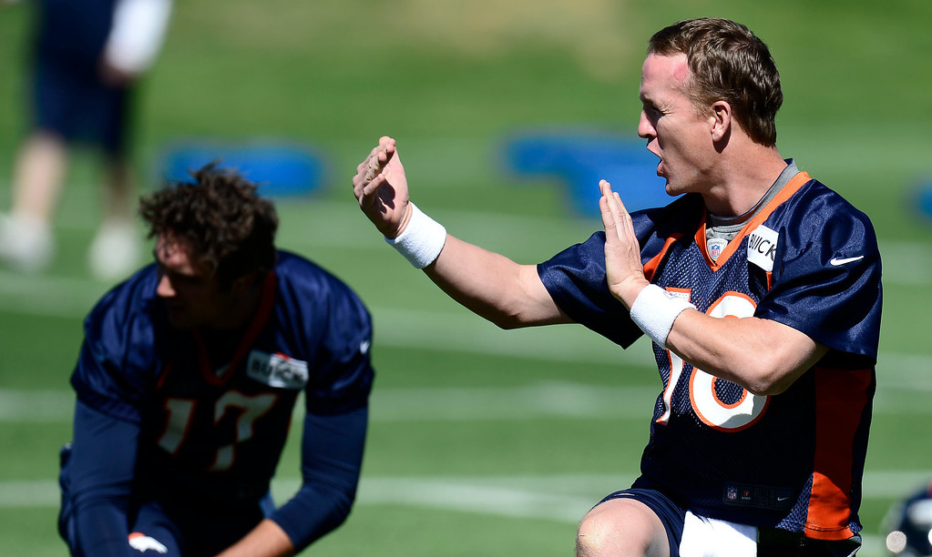 . Denver Broncos quarterback Peyton Manning (18) talks to receivers during OTA\'s May 30, 2013 at Dove Valley. (Photo By John Leyba/The Denver Post)