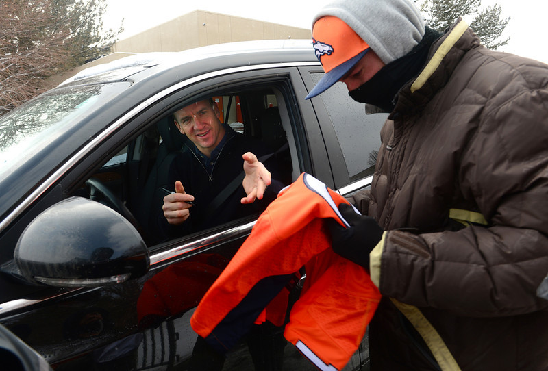 . Denver Broncos quarterback Peyton Manning still has time to sign autographs for fans as he leaves Dove Valley for the season in Englewood, Co on February 4, 2014.   (Photo By Helen H. Richardson/ The Denver Post)