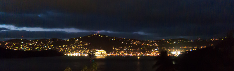 Charlotte Amalie at night, with a cruise ship leaving