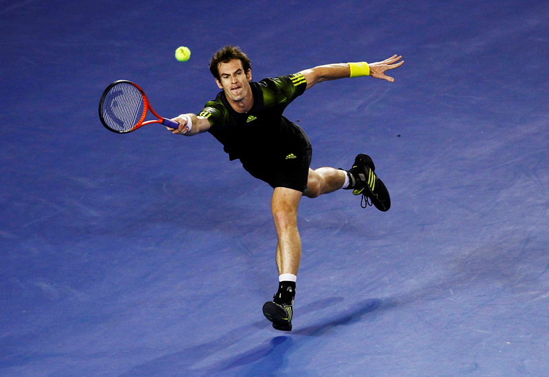 . Andy Murray of Britain hits a return to Novak Djokovic of Serbia during their men\'s singles final match at the Australian Open tennis tournament in Melbourne January 27, 2013. REUTERS/Navesh Chitrakar