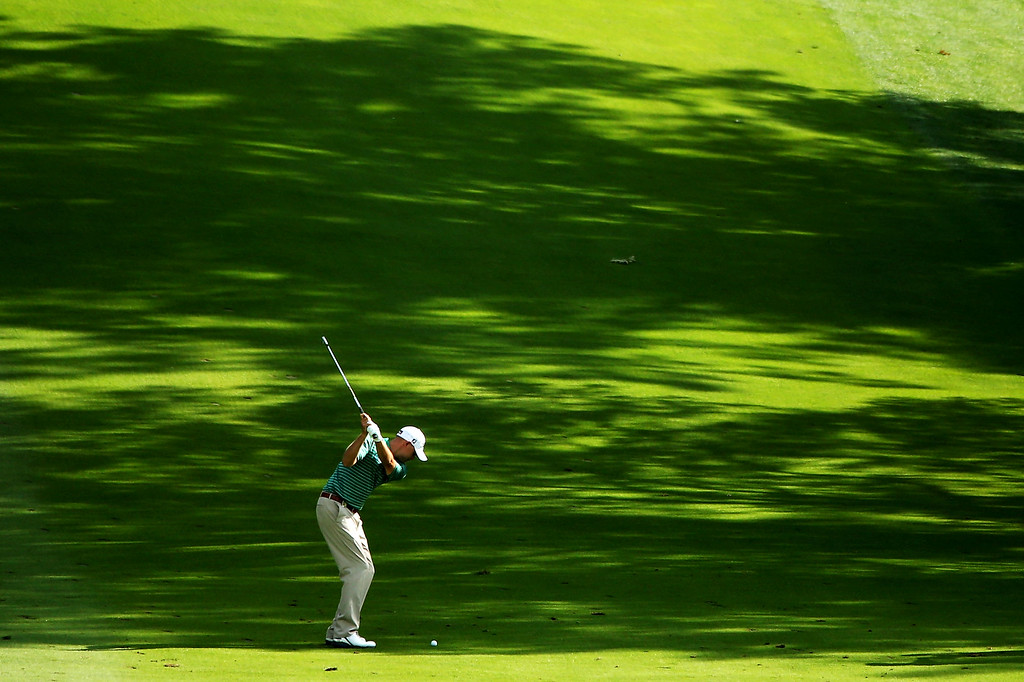 . ROCHESTER, NY - AUGUST 09:  Bill Haas of the United States hits his second shot on the 14th hole during the second round of the 95th PGA Championship on August 9, 2013 in Rochester, New York.  (Photo by Andrew Redington/Getty Images)