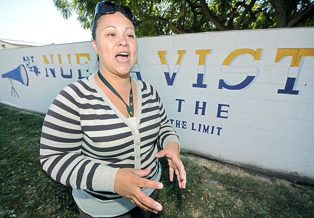 ". Andrea Mendez, parent, discussing how her daughter loves going to school and has become a better student at Nueva Vista High School and does not want to see the closing of the school. The Bassett Unified School Board at Thursday�s meeting will discuss relocating its Nueva Vista High continuation/alternative school back to the Bassett High campus in the 2013-14 school year in order to provide a more cohesive learning environment.  School board member Laura Santos is opposed to the plan since the district spent $1 million to renovate the Nueva Vista campus. It�s unclear what would become of that site. Santos held a  rally with parents and students who oppose the move  Wednesday, April 17, 2013. .""Along with losing an excellent superintendent and terminating an award winning choir and music program, Santos sees this as part of a series of recent bad decisions,\"" Santos said (SGVN/Photo by Walt Mancini)"