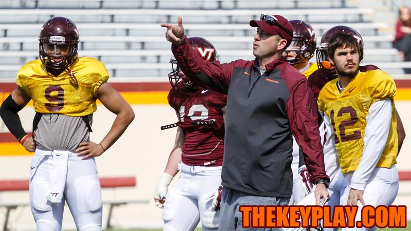 Offensive coordinator Scot Loeffler talks with his quarterbacks during position drills. (Mark Umansky/TheKeyPlay.com