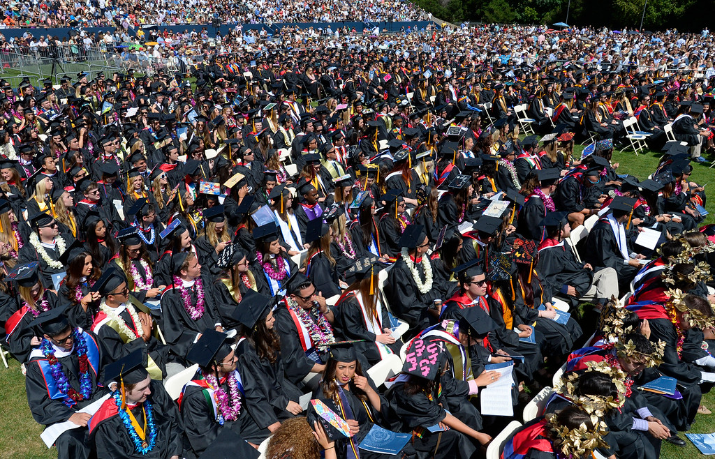 . Students sit and listen to Saint Mary\'s College president James A. Donahue speak during the 2014 Saint Mary\'s College commencement ceremony in Moraga, Calif., on Saturday, May 24, 2014. A total of 758 students graduated making this the largest graduating class in school history. (Jose Carlos Fajardo/Bay Area News Group)
