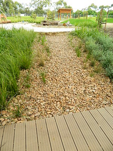 gravel swale with grase plantings