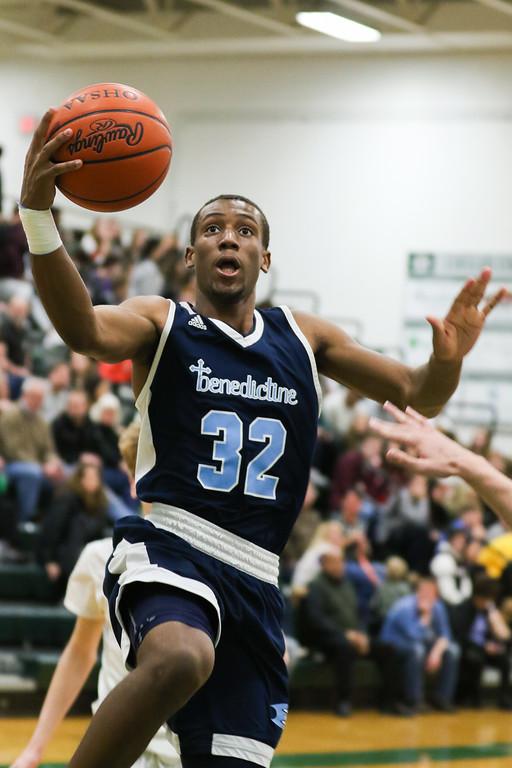. 2018 - Basketball - Benedictine at Lake Catholic.  Benedictine defeated Lake Catholic 63-56.  Benedictine\'s Chris Jefferson (32) puts up a layup.