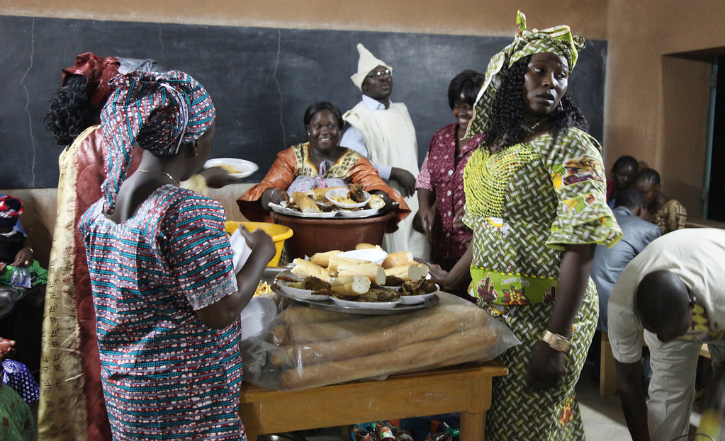 . In this photo taken Saturday, Dec. 24, 2016, Catholic faithful share a meal to celebrate Christmas at Philippe Amore Catholic Church in Goa, Mali. Just four years ago strict Islamic law was in force in this town, but Christians have returned to rebuild their congregation that fled the jihadist occupation. (AP Photo/Baba Ahmed)