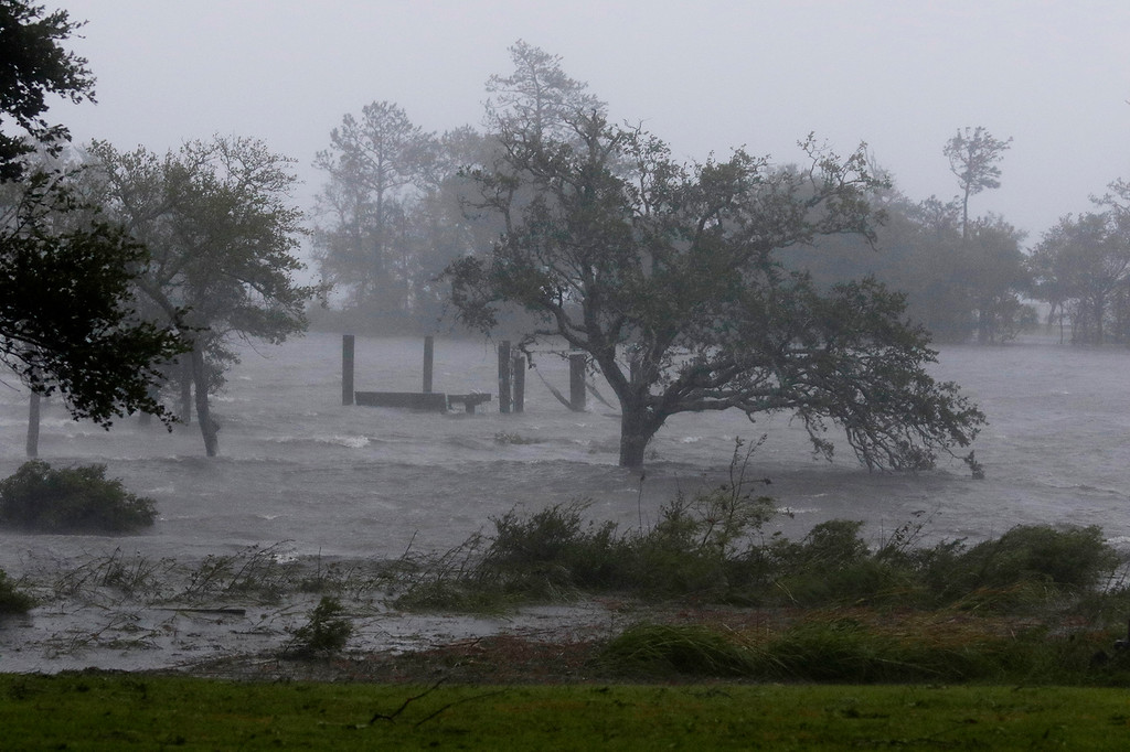 . High winds and storm surge from Hurricane Florence hits Swansboro N.C., Friday, Sept. 14, 2018. (AP Photo/Tom Copeland)