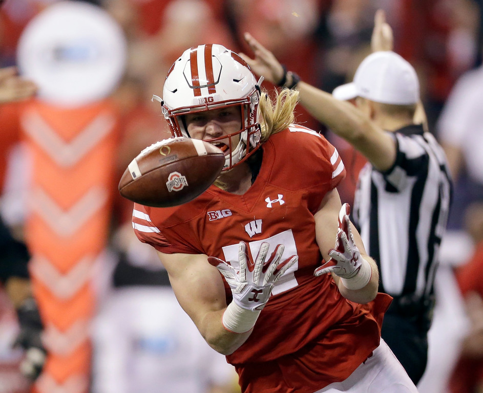 . Wisconsin linebacker Andrew Van Ginkel recovers a fumble during the first half of the Big Ten championship NCAA college football game against Ohio State, Saturday, Dec. 2, 2017, in Indianapolis. (AP Photo/AJ Mast)