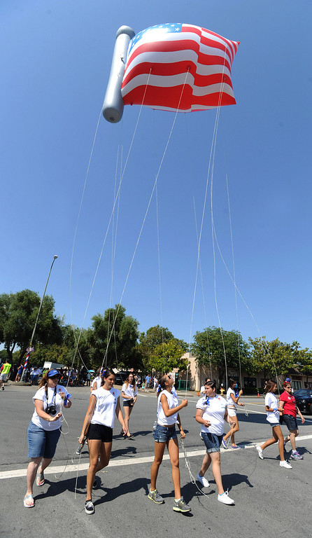 . Helium filled entrants are back after a year absence, due to a shortage of helium last year, at the Fourth of July parade in Fremont, Calif., on Thursday, July 4, 2013. The parade featured more than 70 entries. (Dan Honda/Bay Area News Group)