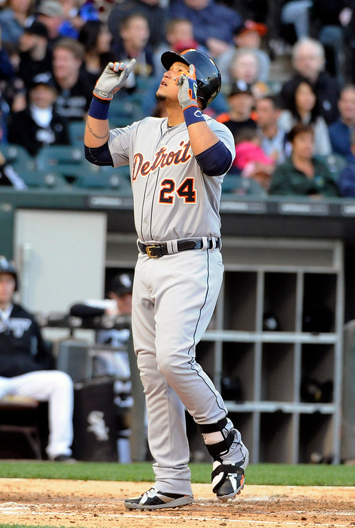 . Detroit Tigers\' Miguel Cabrera (24) points skyward after crossing home plate after hitting a two-run homer against the Chicago White Sox during the fifth inning of a baseball game, Saturday, June 6, 2015 in Chicago.  (AP Photo/David Banks)
