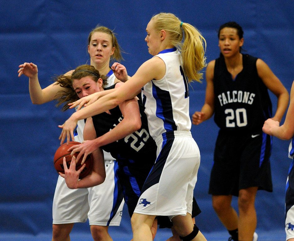 . PARKER, CO. - FEBRUARY 15: Ranch senior forward Kelsey Wainright (25) fought for a rebound in the first half. The Legend High School girls\'s basketball team hosted Highlands Ranch Friday night, February 15, 2013. (Photo By Karl Gehring/The Denver Post)