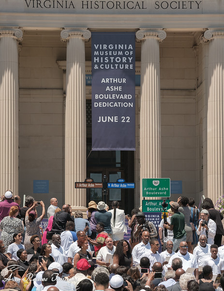 The crowd and media rush to capture images of the newly revieled Arthurh Ashe Boulevard Street signs on June 22, 2019
