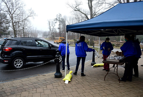 3/17/2020 Mike Orazzi | Staff Members of the Bristol Burlington Health District while handing out free lunches to school children at Rockwell Park on Tuesday morning.