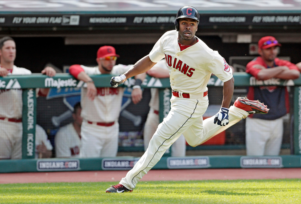 . Cleveland\'s Michael Bourn races home to score on a single by Nick Swisher in the eighth inning against the Twins. (AP Photo/Mark Duncan)