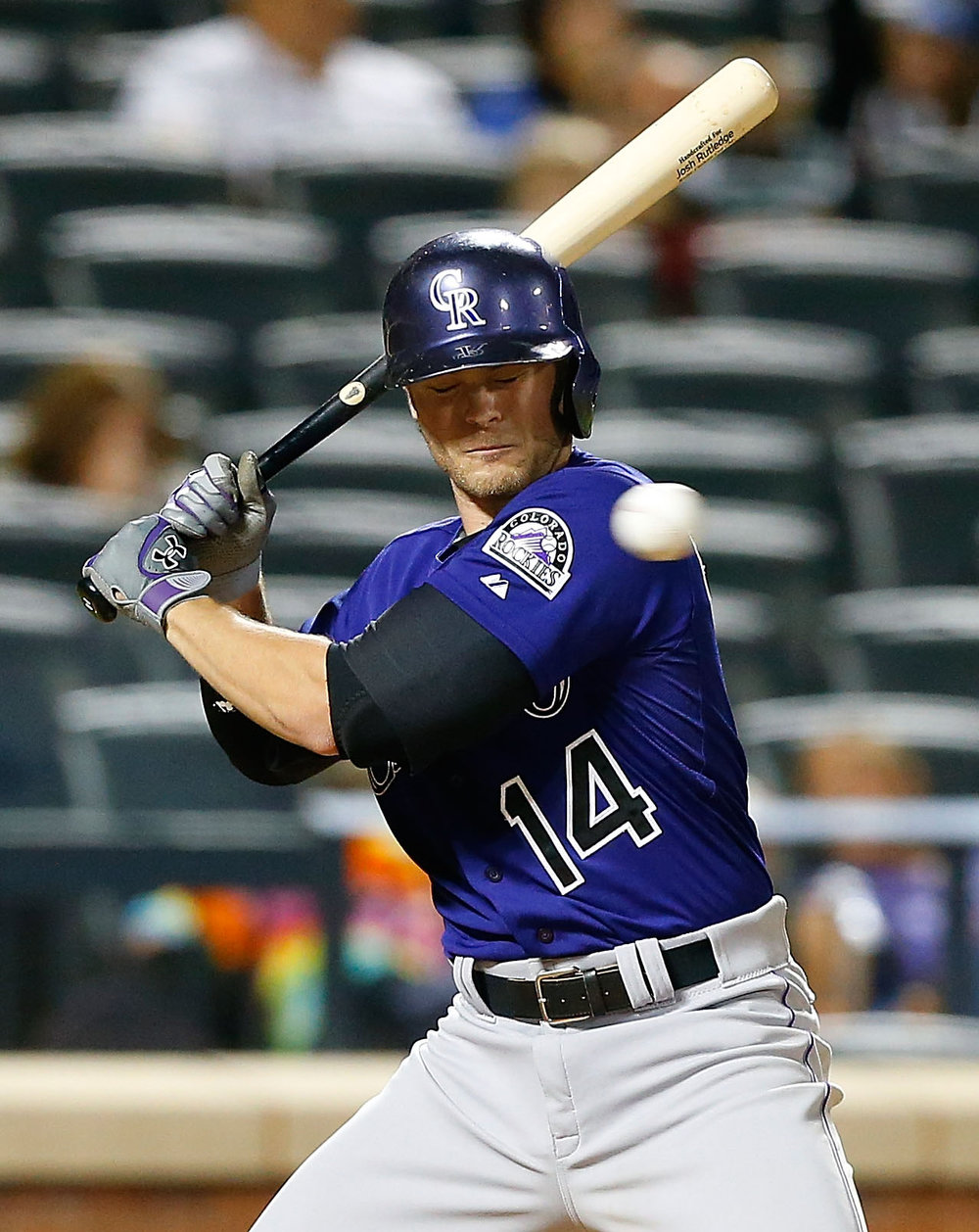 . Josh Rutledge #14 of the Colorado Rockies avoids an inside pitch in the seventh inning against the New York Mets at Citi Field on September 8, 2014 in the Flushing neighborhood of the Queens borough of New York City.  (Photo by Jim McIsaac/Getty Images)