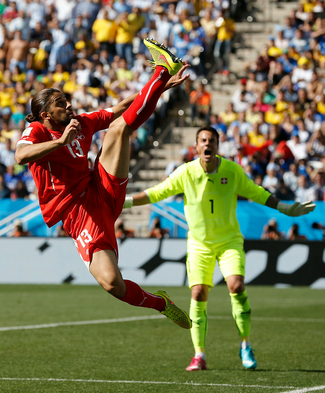 . Switzerland goalkeeper Diego Benaglio shouts out as Switzerland\'s Ricardo Rodriguez clears the ball during the World Cup round of 16 soccer match between Argentina and Switzerland at the Itaquerao Stadium in Sao Paulo, Brazil, Tuesday, July 1, 2014. (AP Photo/Frank Augstein)