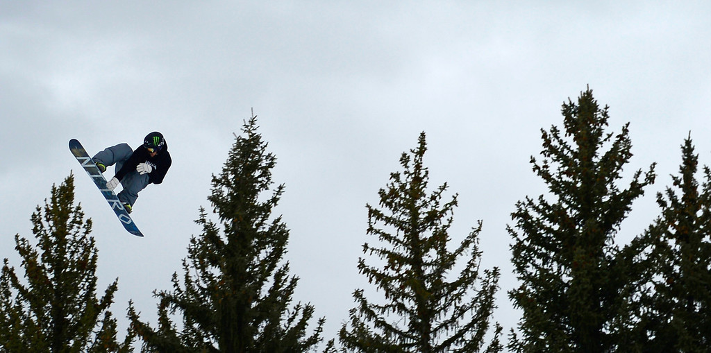 . ASPEN, CO. - JANUARY 24: Gjermund Braaten rides above the trees during the men\'s Snowboard Slopestyle elimination. Men\'s Snowboard Slopestyle elimination X Games Aspen Buttermilk Mountain Aspen January 24, 2013. (Photo By AAron Ontiveroz / The Denver Post)