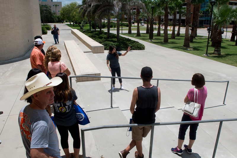 A campus tour guide leads prospective students and their families to the next stop on their tour after visiting the O'Connor building.  Schedule your campus tour here: http://tour.tamucc.edu/