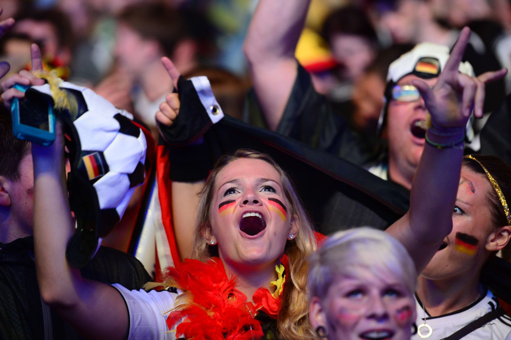 Description of . A Germany fan reacts during the FIFA World Cup 2014 semi final football match between Germany and Brazil during a public viewing at the Brandenburg Gate in Berlin on July 8, 2014. (JOHN MACDOUGALL/AFP/Getty Images)