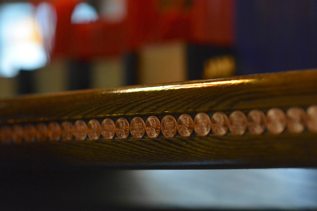 . The downstairs bar edge at the Three Blind Mice pub in Mount Clemens is trimmed with 2013 copper pennies. Ray J Skowronek / Digital First Media