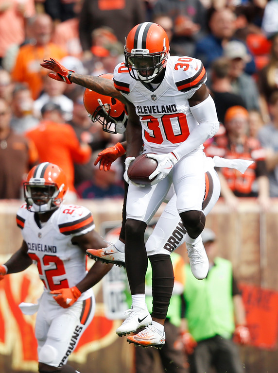 . Cleveland Browns defensive back Jason McCourty (30) celebrates an interception with cornerback Jamar Taylor (21) during the first half of an NFL football game against the New York Jets, Sunday, Oct. 8, 2017, in Cleveland. (AP Photo/Ron Schwane)