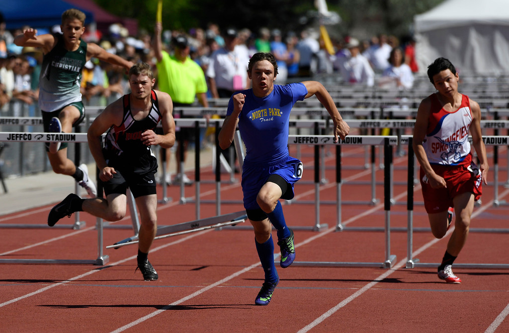 . Blayden  Fletcher, North Park, center, heads to the finish line taking first place in the 1A 110 meter hurdles at the Colorado Track and Field State Championships at Jeffco Stadium May 21, 2016. (Photo by Andy Cross/The Denver Post)