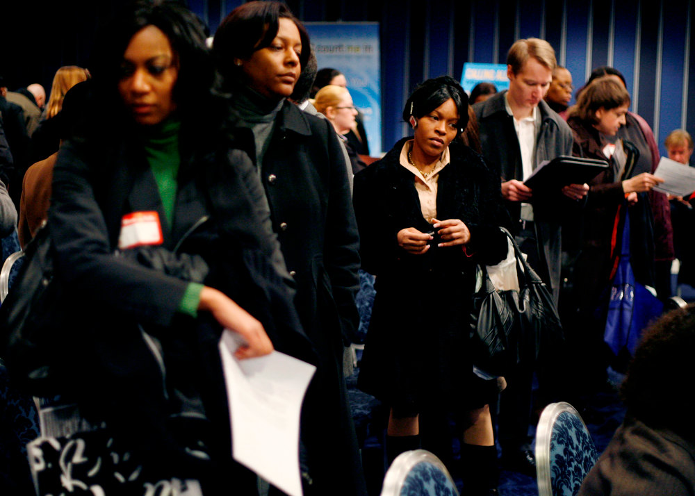 . In this Tuesday, Feb. 24, 2009 file photo, people wait in line to talk to career counselors at a crowded job fair in New York. Thousands waited in line for two or more hours to enter the fair where about forty employers were talking to perspective hires. (AP Photo/Seth Wenig)