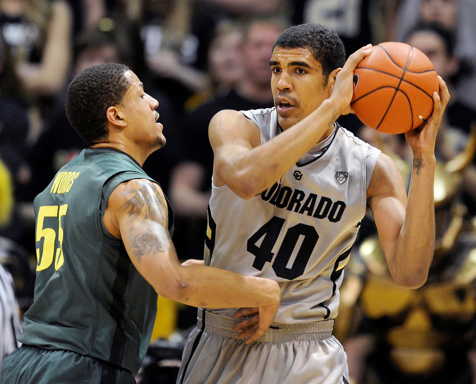 . BOULDER, CO. - MARCH 7: Colorado center Josh Scott (40) looked for a way around Oregon center Tony Woods (55) in the first half. The University of Colorado men\'s basketball team hosted Oregon Thursday night, March 7, 2013 at the CU Events Center in Boulder. (Photo By Karl Gehring/The Denver Post)