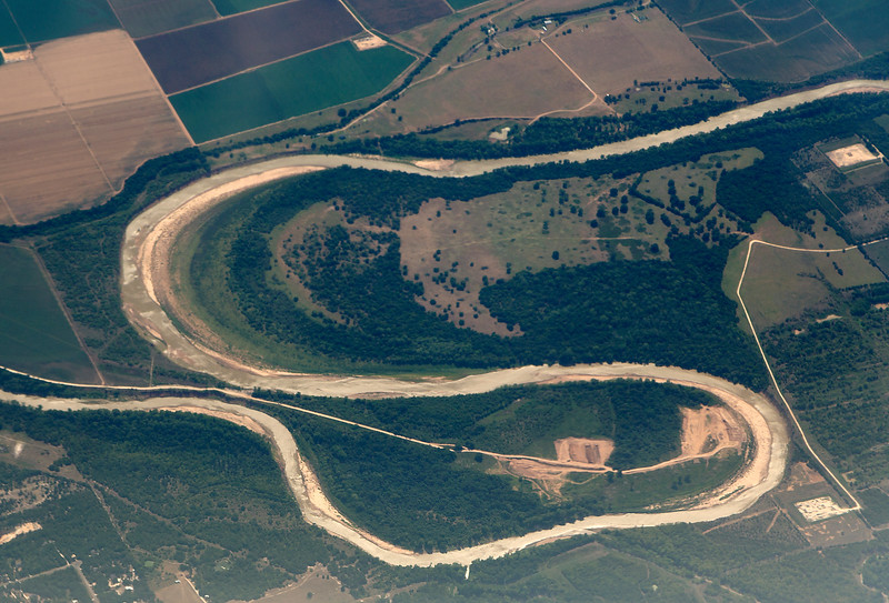 A bayou has almost finished forming an Oxbow.