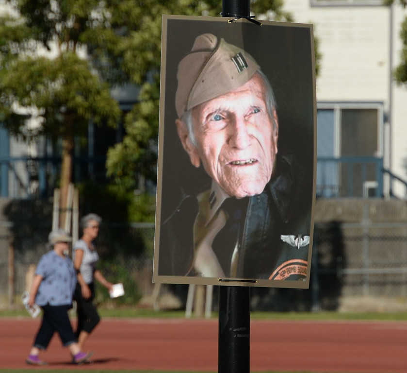 . Photos of Louis Zamperini adorn light poles for a memorial for the Torrance legend, who died earlier this month Thursday, July 31, 2014, Torrance, CA.  Zamperini was an Olympian, WWII bomber pilot and Japanese POW. A book by Laura Hildebrand titled Unbroken documented his life and a movie directed by Angelina Jolie will be released in December. Photo by Steve McCrank/Daily Breeze