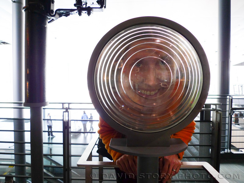 An exhibit at the Corning Museum of Glass helps visitors to understand the magnification of light from a lighthouse lamp.