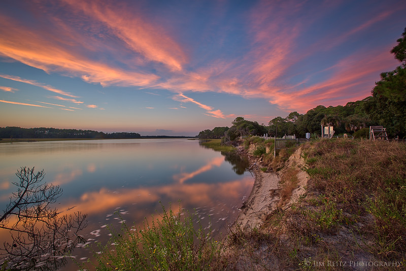 Brilliant pink clouds just after sunset, reflected in the peaceful Kiawah River - on Kiawah Island, South Carolina.