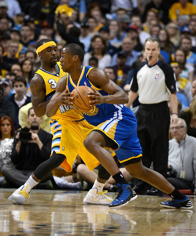 . DENVER, CO. - APRIL 20: Golden State Warriors small forward Harrison Barnes (40) drives to the basket against Denver Nuggets point guard Ty Lawson (3) in the first quarter. The Denver Nuggets took on the Golden State Warriors in Game 1 of the Western Conference First Round Series at the Pepsi Center in Denver, Colo. on April 20, 2013. (Photo by John Leyba/The Denver Post)