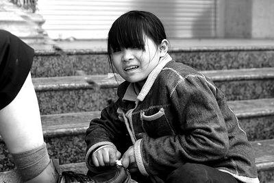 Shoeshine girl - Yunnan, China