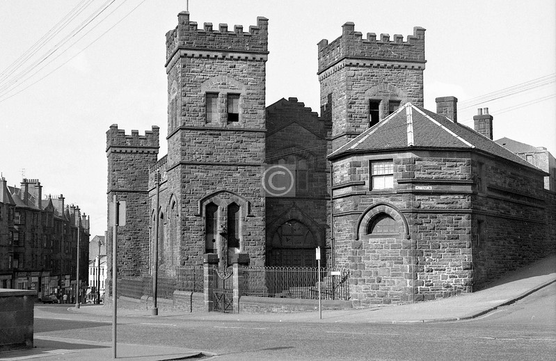 High St at Rottenrow. This imposing baronial structure was a hydraulic pumping station for the Glasgow Waterworks. It operated from 1895 to 1964, and was demolished  a few months after I took this in April 1973