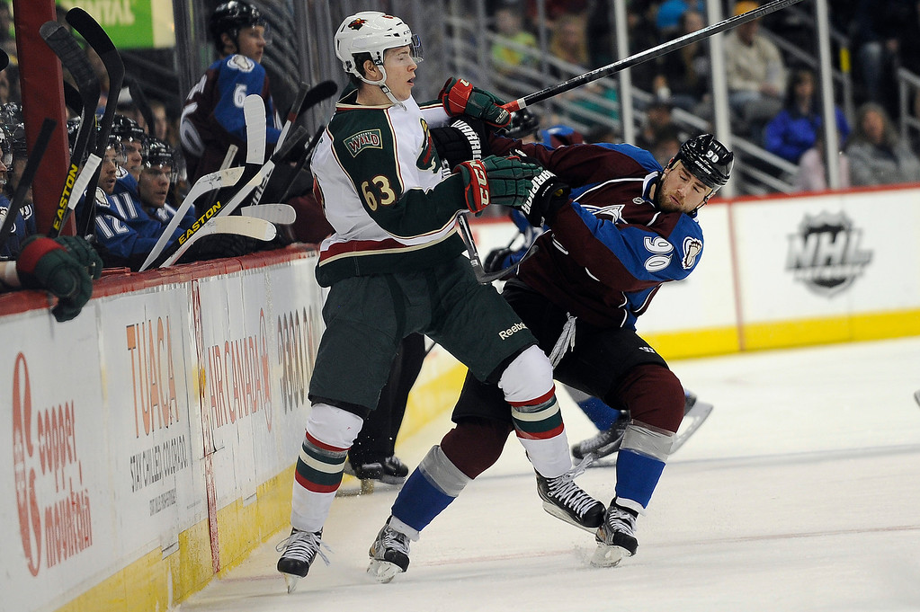 . Charlie Coyle (63) of the Minnesota Wild  stands up Ryan O\'Reilly (90) of the Colorado Avalanche as O\'Reilly attempts an open ice check during the first period, Saturday, April 27, 2012 at Pepsi Center. Seth A. McConnell, The Denver Post