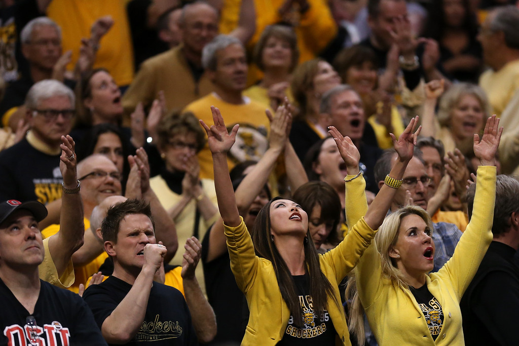 . LOS ANGELES, CA - MARCH 30:  Wichita State Shockers fans cheer on their team in the second half while taking on the Ohio State Buckeyes during the West Regional Final of the 2013 NCAA Men\'s Basketball Tournament at Staples Center on March 30, 2013 in Los Angeles, California.  (Photo by Jeff Gross/Getty Images)